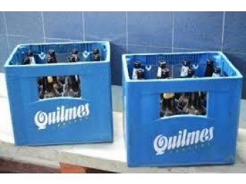 Dos cajones de cervezas c sus envases